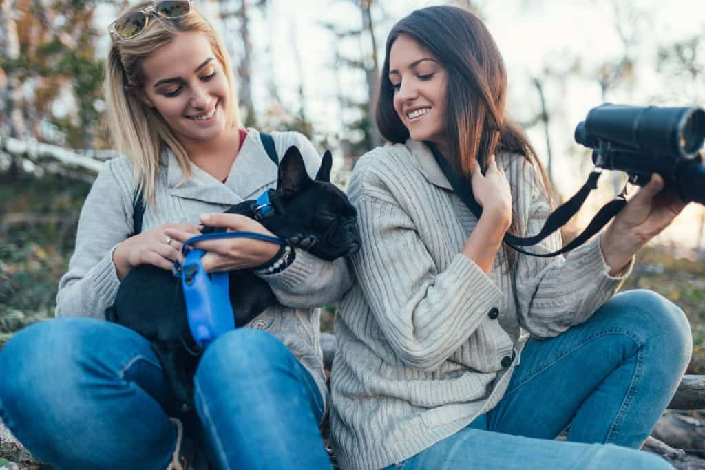 Women with a black french bulldog