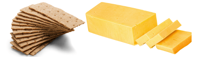 crackers and cheese on white background