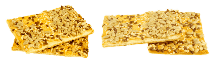 crackers with sesame seeds on white background