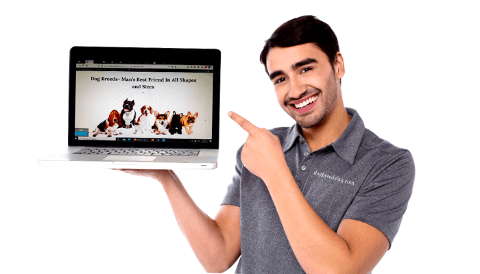 smiling man holding a laptop on his right hand